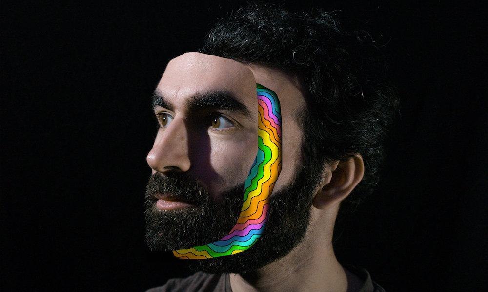 Adam Schatz with a face mask on